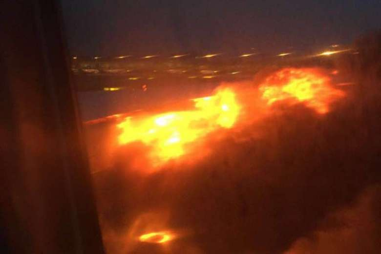 Singapore Airlines Boeing 777 catches fire after emergency landing